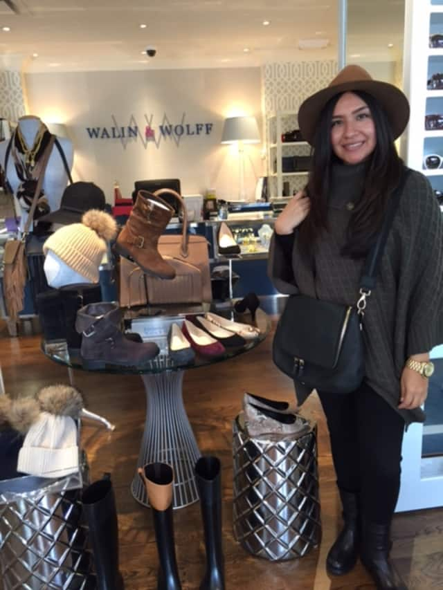 Salesperson Minerva Flores of Walin & Wolff models some fall items.
