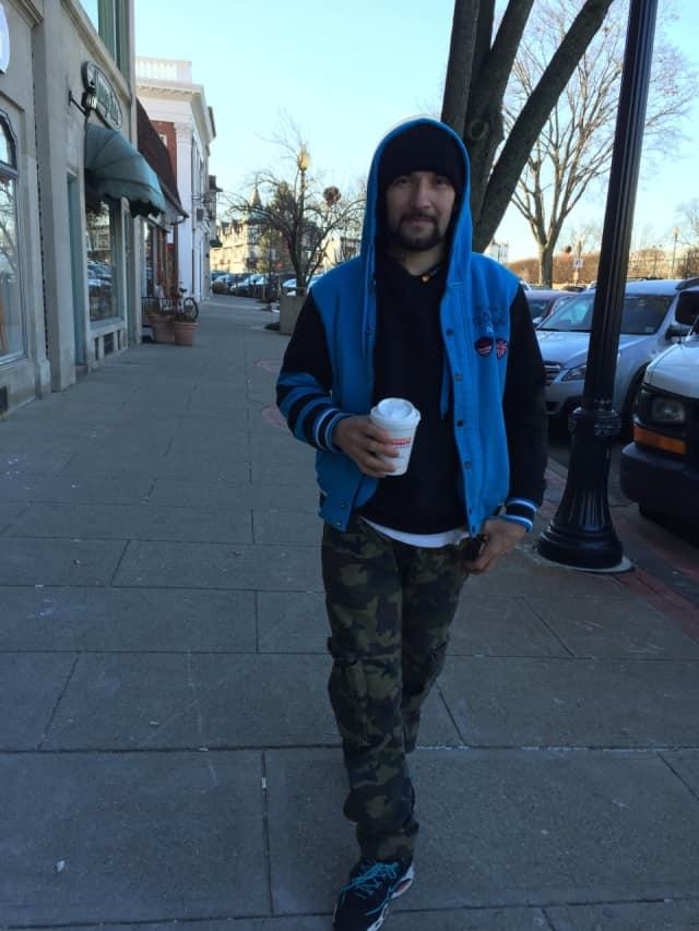 A Ridgewood shopper keeps warm with coffee.