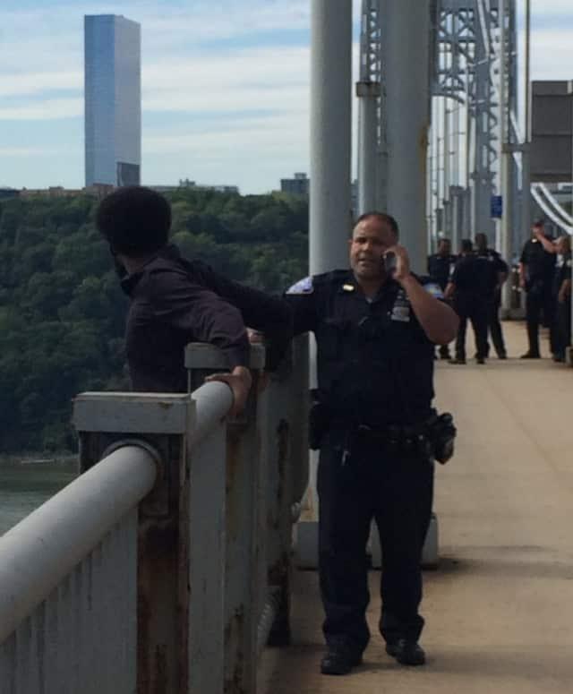 PAPD Officer Juan Guzman convinces him not to jump.