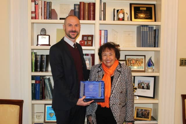 "Justin Goodman, vice president of advocacy and public policy for White Coat Waste Project with Rep. Nita Lowey, receiving a ""Congressional Waste Warrior"" for supporting legislation to end government spending on animal testing."