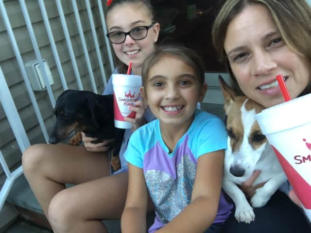 Smoothie King owner Denise Cinque MacDonald, right, with her girls (from left) Lindsey and Kate, and their two dogs.