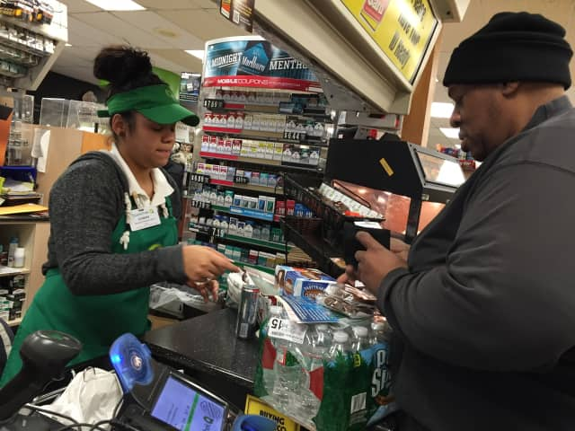 Melvin of Teaneck purchases a Powerball ticket along with a case of water at QuickChek in Bogota.