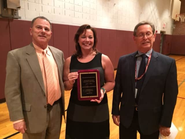(from left) Superintendent of Schools Joseph Abate, McKenzie School Teacher of the Year Beth Narkiewicz and East Rutherford Board of Education President Paul Weiss
