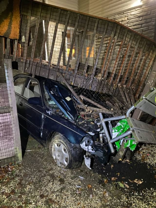 A driver allegedly lost control of his vehicle and crashed into the porch of a home.