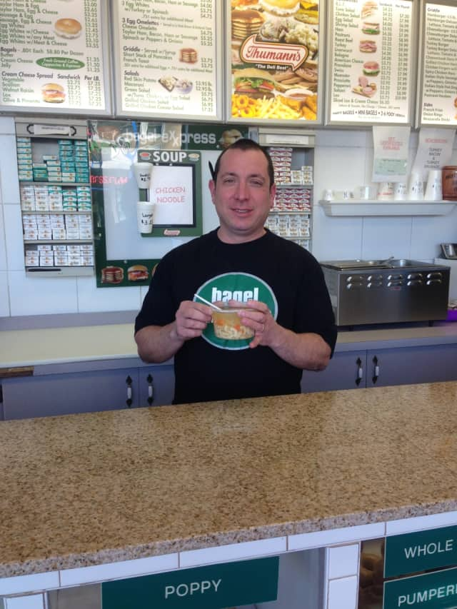 Frank Scola of Hawthorne's Bagel Express with housemade chicken noodle soup.