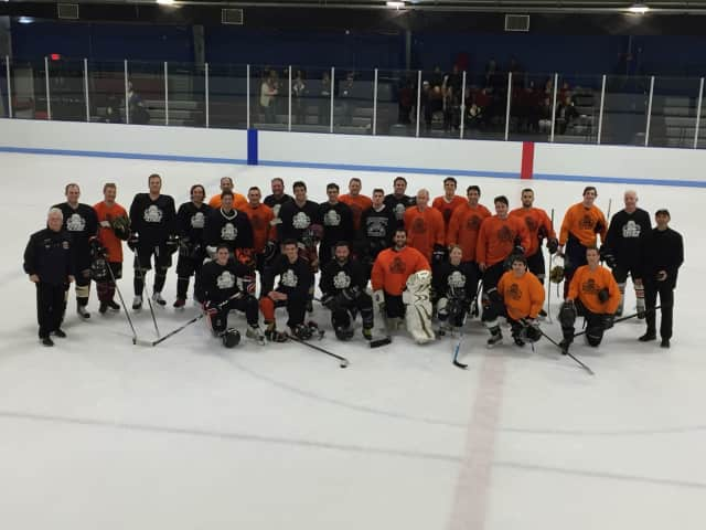 Alumni from Mamaroneck hockey programs on the ice at Hommocks Arena on Monday.