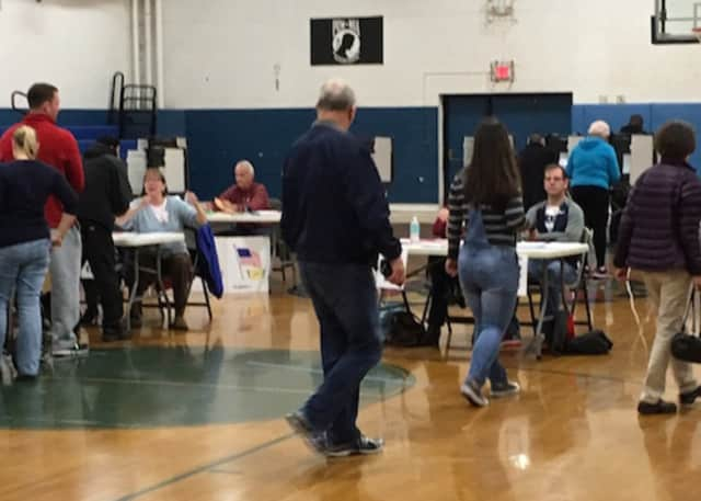 Voters enter the gym at the War Memorial in Danbury to cast their ballots on Tuesday, Nov. 8. The state will be conducting hand counts of votes cast at random polling places that used optical scanners.