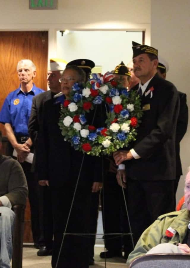Members of local veterans organizations placed a memorial wreath during the 2016 Veterans Day services at Westport Town Hall.