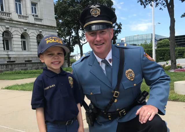 Alex Hammer, 4, poses with Washington Township Police Lt. Rich Skinner.