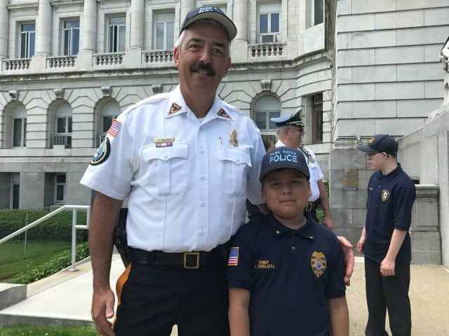 "Park Ridge Police Chief Joseph Madden stands with ""Police Chief for a Day"" Angel Ocelotl."