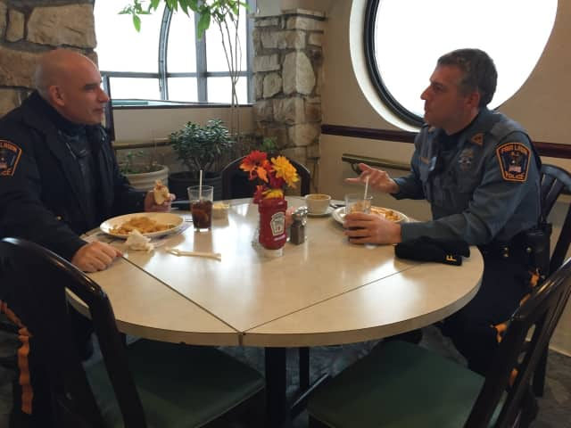 Officers Rob Manning and Steve Buskiewicz enjoy soda and fries before returning to work.