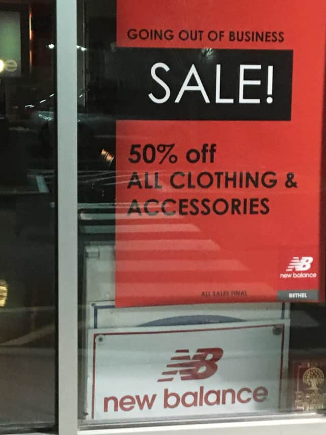 New Balance Bethel posted a sign that indicates the store is going out of business. A new store that sells athletic footwear and apparel is expected to fill the space.