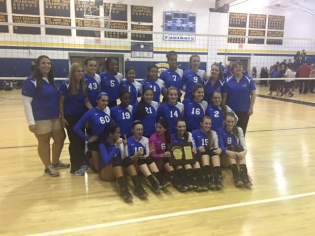 The Hendrick Hudson varsity volleyball team, after winning the Section 1 Class B Championship at Walter Panas High School.