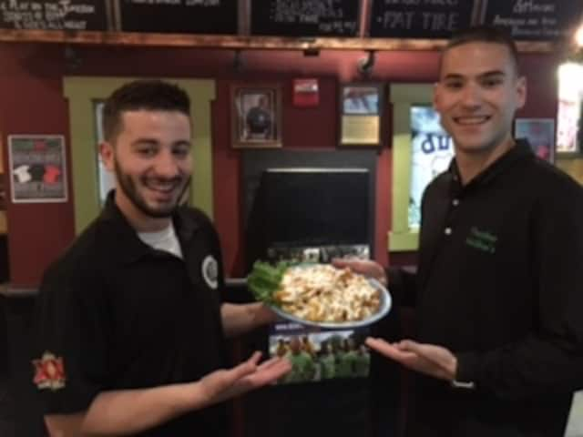 Alexio and Jordan, servers at Thatcher's McGhee's in Pompton Lakes, with the always popular Thatch fries.