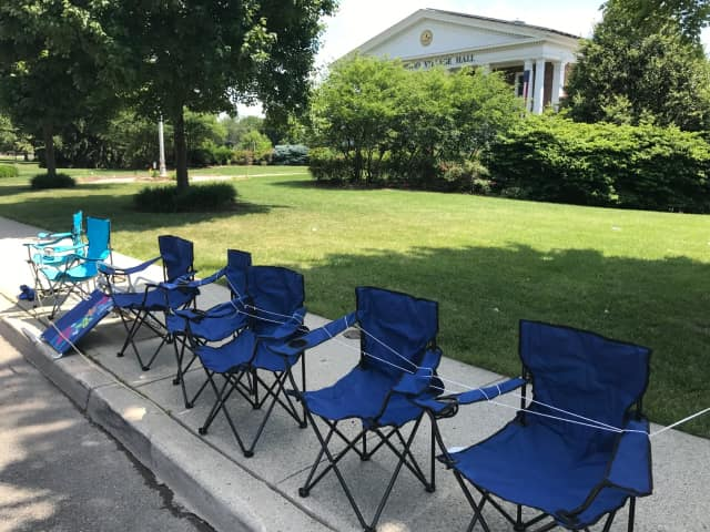 Chairs are set up on North Maple Avenue in front of Ridgewood Village Hall.