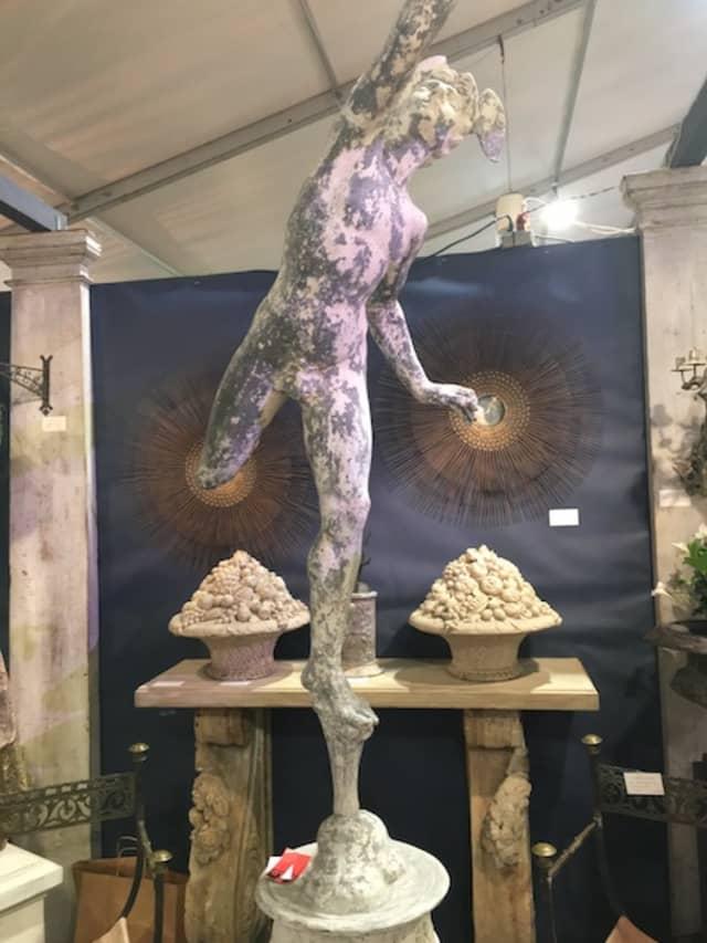 "A garden sculpture of Giambologna's ""Mercury,"" part of the Withington & Co. display at the New York Botanical Garden's recent Garden Art & Antiques Fair."