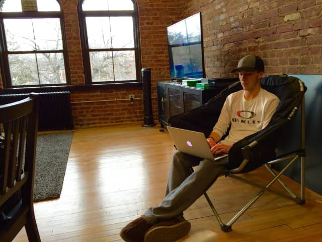 Connor Bruggemann of Investor's Corner hangs out in his fifth-floor office in Ridgewood's Lincoln Building, home of Serendipity Labs first coworking location.