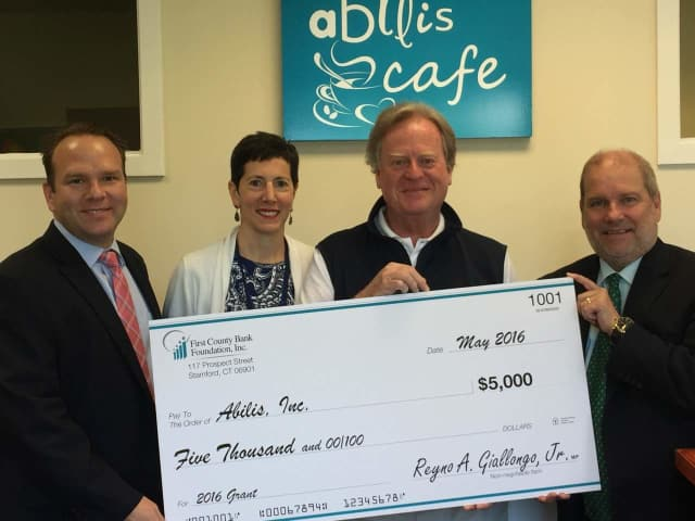 Richard Evanko, vice president of First County Bank, Nancy Heller, Abilis director of development, Dennis Perry, Abilis president/CEO and Jeff Robinson, First County Bank Greenwich branch manager participated in the recent check presentation.