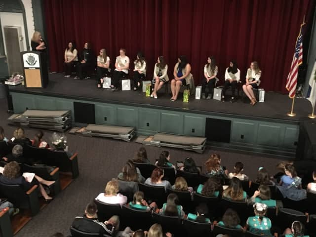 Holly Schepisi addressed the New Milford Girl Scouts on Tuesday, at their award ceremony.