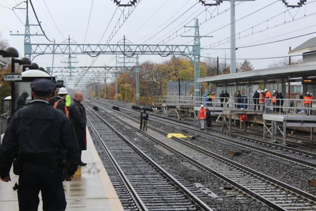 Emergency responders at the Stratford train station Wednesday after a man was hit and killed by an Amtrak train.
