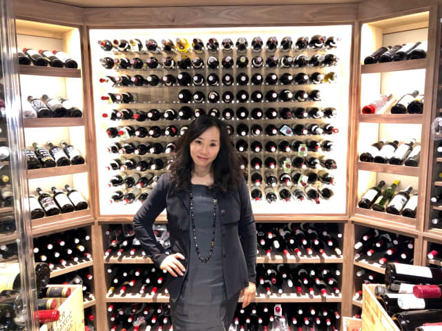 Christine Bae's 1,500-bottle wine cellar in her Norwood home is beyond capacity. Her collection has grown to 3,000 bottles.