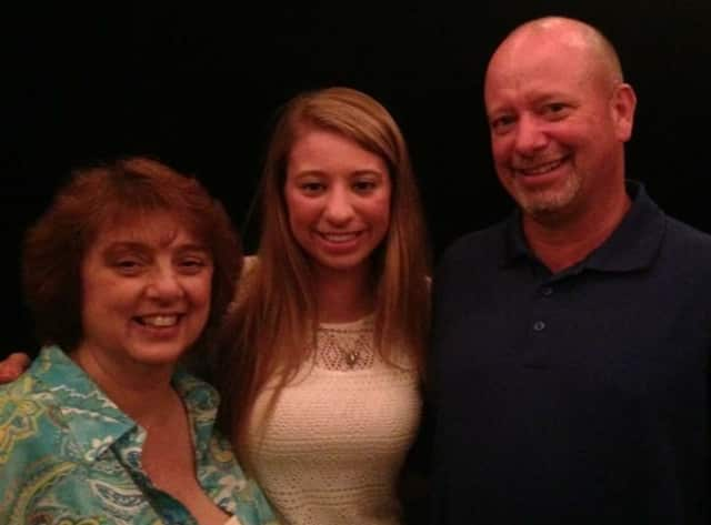 Lauren Rhein poses with her mother and father.
