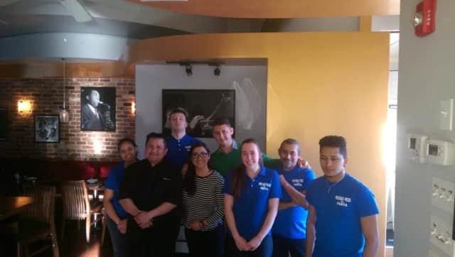 The staff at Piccolo Pizza in Ridgefield. Left to right: Isadora, Roberto, Matt, Christina, Leonardo, Claire, Mario and Roberto.