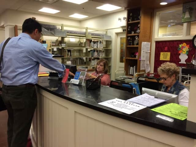 Franklin Lakes Public Library staff help a visitor Tuesday, Oct. 27.