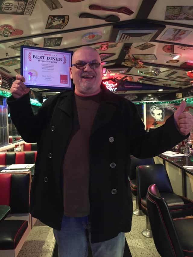 Harry Mihas of Oakland Diner with his DVlicious certificate.
