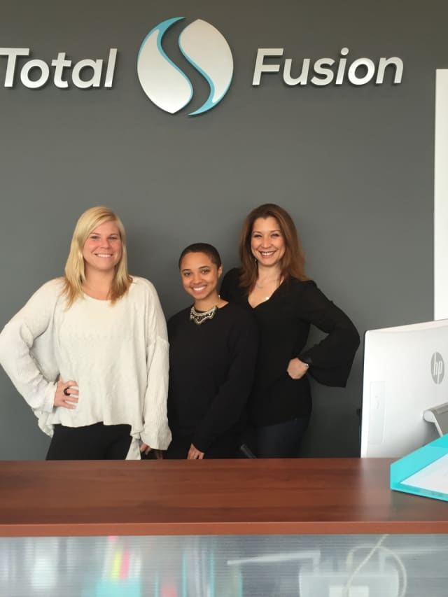 Some of the staff at the new TotalFusion in Harrison; left to right, Megan Carron, Stephanie Jiminez, and Toni DAmario (Fiore).