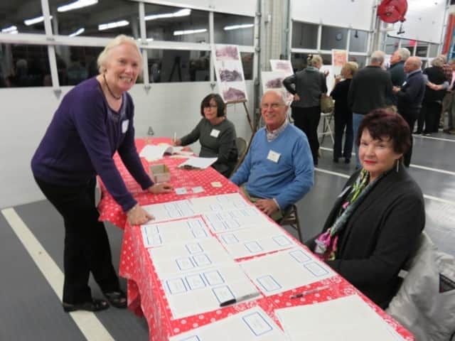 Regina Vassak, Susie Thompson, John Vassak and Jane Knox at the reception desk at the North Salem Historical Society's annual meeting at the new Croton Falls Firehouse.
