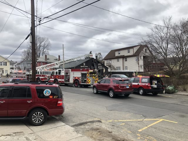 Danbury firefighters worked to extinguish a fire at Mina's Carne and Deli.