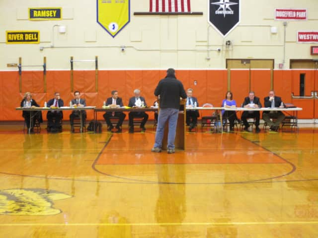 Residents speak to the Dumont Mayor and Council during a special public meeting on March 8.