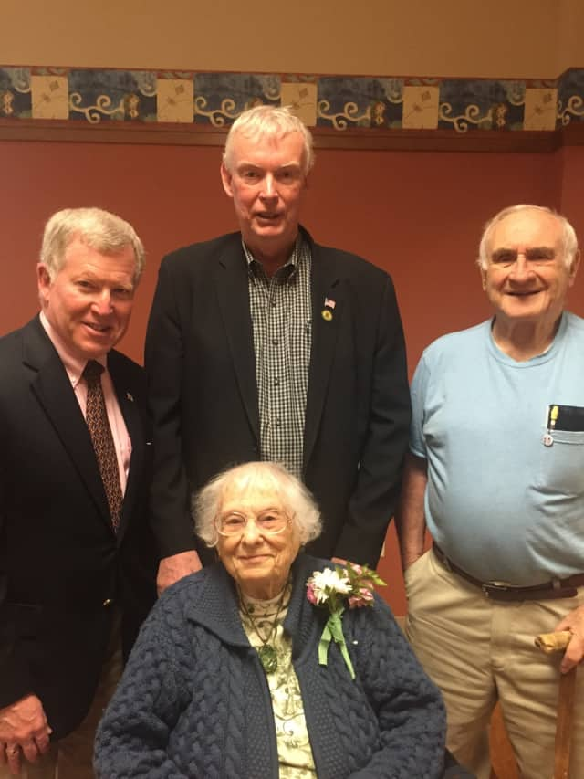 Posing with Mary Burdick are, from left, Sen. Bob Gordon, John Cosgrove and Marty Etler.