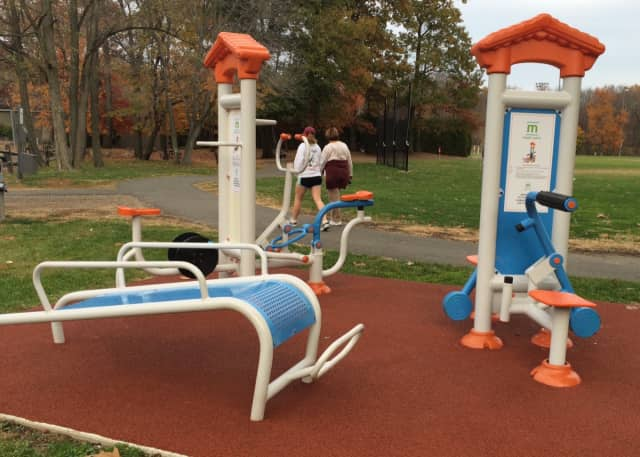 People walk through Municipal Field in Franklin Lakes, now including fitness equipment.