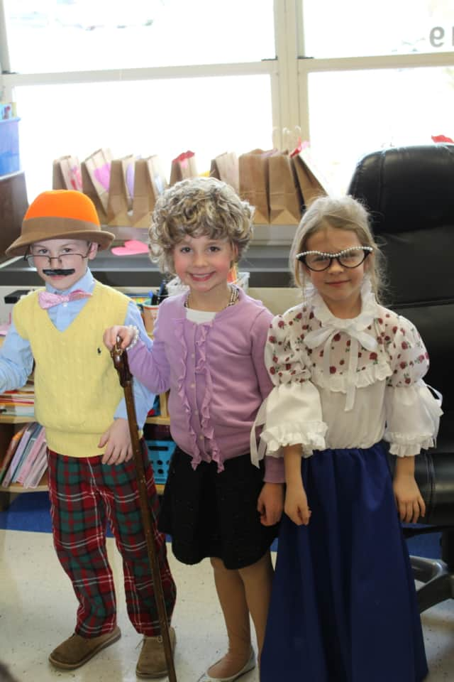 Ox Ridge first-graders Blake DeRiso, Peyton Ochman and Quin Chandler celebrate 100 days of school by dressing up as 100 year olds.