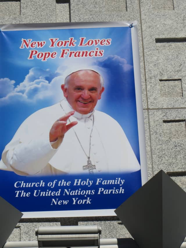 A poster above Holy Family Church near the United Nations in Manhattan anticipated Thursday's arrival of Pope Francis.