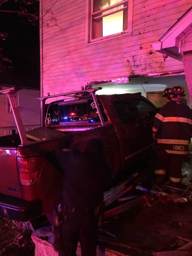 Three people suffered injuries when a pickup truck slammed into a house in Danbury early Saturday morning.