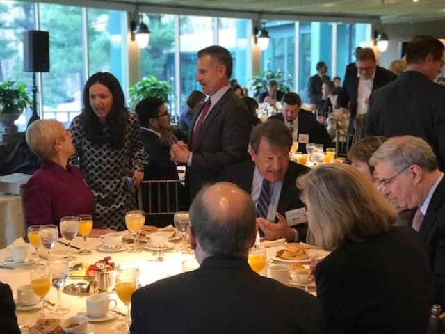Westchester County Executive George Latimer, seated, chats with business leaders before a speech on Wednesday. Marsha Gordon, president/CEO of the Business Council of Westchester, is seated on the left.