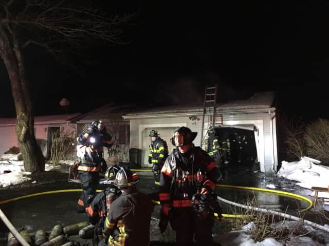 Firefighters battle the blaze that broke out just before 1 a.m. Saturday at 8 Indian Spring Road in the Candlewood Lake area.