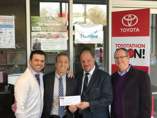 Tony Dovolani, left, poses with Kennedy Center President Martin Schwartz, Salvatore Giugno of Toyota of Stamford andStratford resident George Perham of Antinozzi Associates, who organized the charity event.