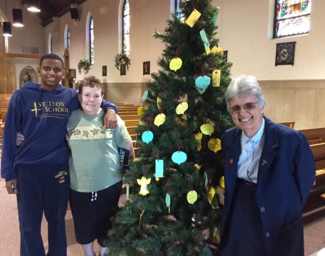 From left, St. Leo's student John Mayo, 13, Barbara Rubino and Sister Alice Francis with the Giving Tree.