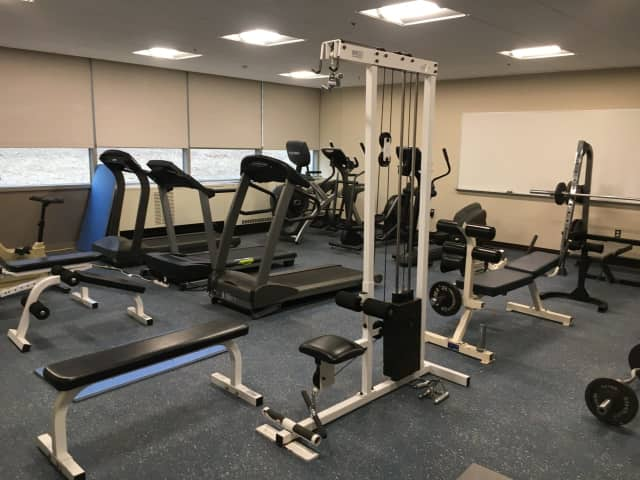 A fitness room with exercise equipment offers a convenient workout place for residents at the Comstock Community Center in Wilton.