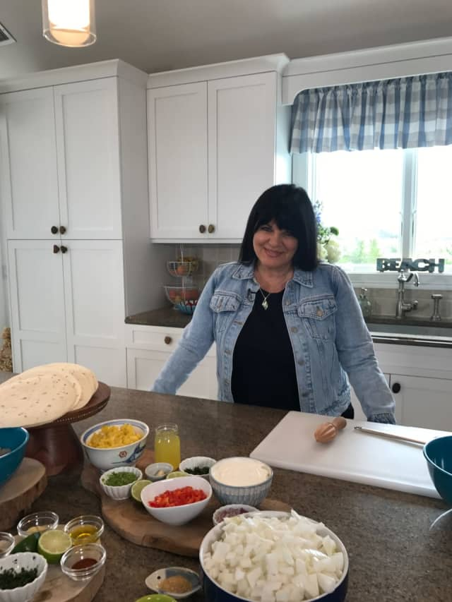 Andrea Anthony prepares a meal in her kitchen for the new PBS series Eat, Drink And Bake with Andrea