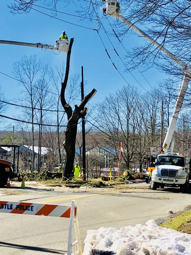 Utility crews trimming trees and restoring power lines along Bedford Road at Maple Avenue in Armonk.