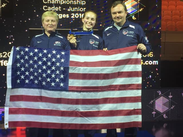 Binder with her coaches following her victory.