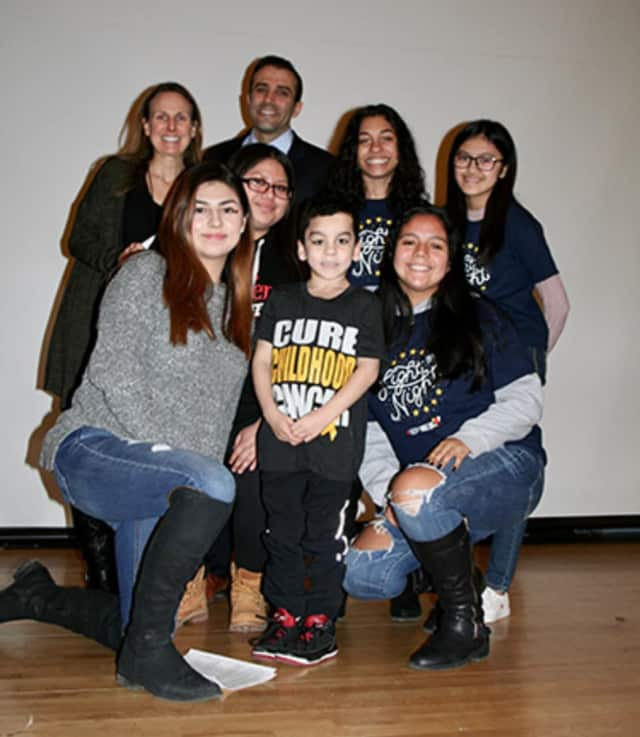 Gio, a 6-year-old Ossining boy helped by Elmsford students who are running a fundraiser related to blood cancer research, with teacher Lisa Watson and Alexander Hamilton High School Principal Joseph Engelhardt.