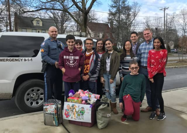 A group of Ben Franklin Middle School students collected a bin of toys for the Ridgewood Police Department.