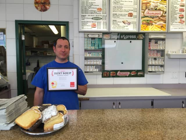 """Frank Scola of Bagel Express in Hawthorne poses with his DVlicious """"Best Soup"""" award."""