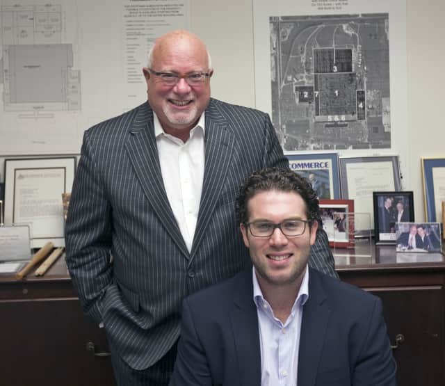 Jaime (standing) and Matthew Weiss manage Moonachie's Weiss Realty, and leverage their half-century of real-estate experience.